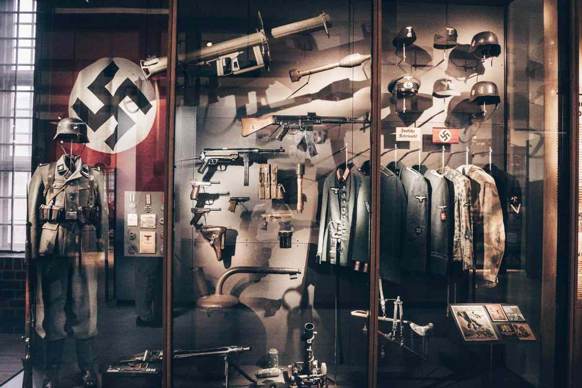 Military uniforms, rifles, and helmets on display at the Danish War Museum in Copenhagen