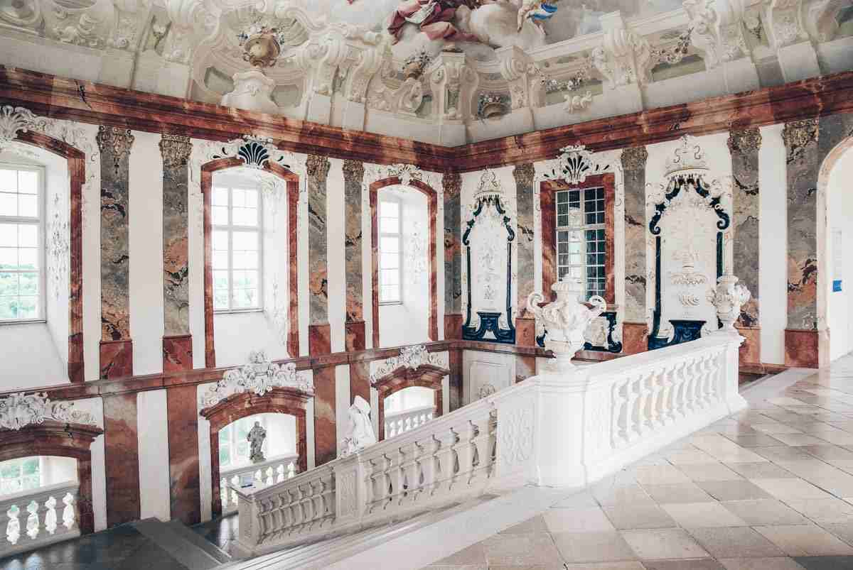 The grand imperial staircase of the Altenburg Abbey. PC: Christian Jansky (User:Tschaensky) / CC BY-SA (https://creativecommons.org/licenses/by-sa/3.0), via Wikimedia Commons