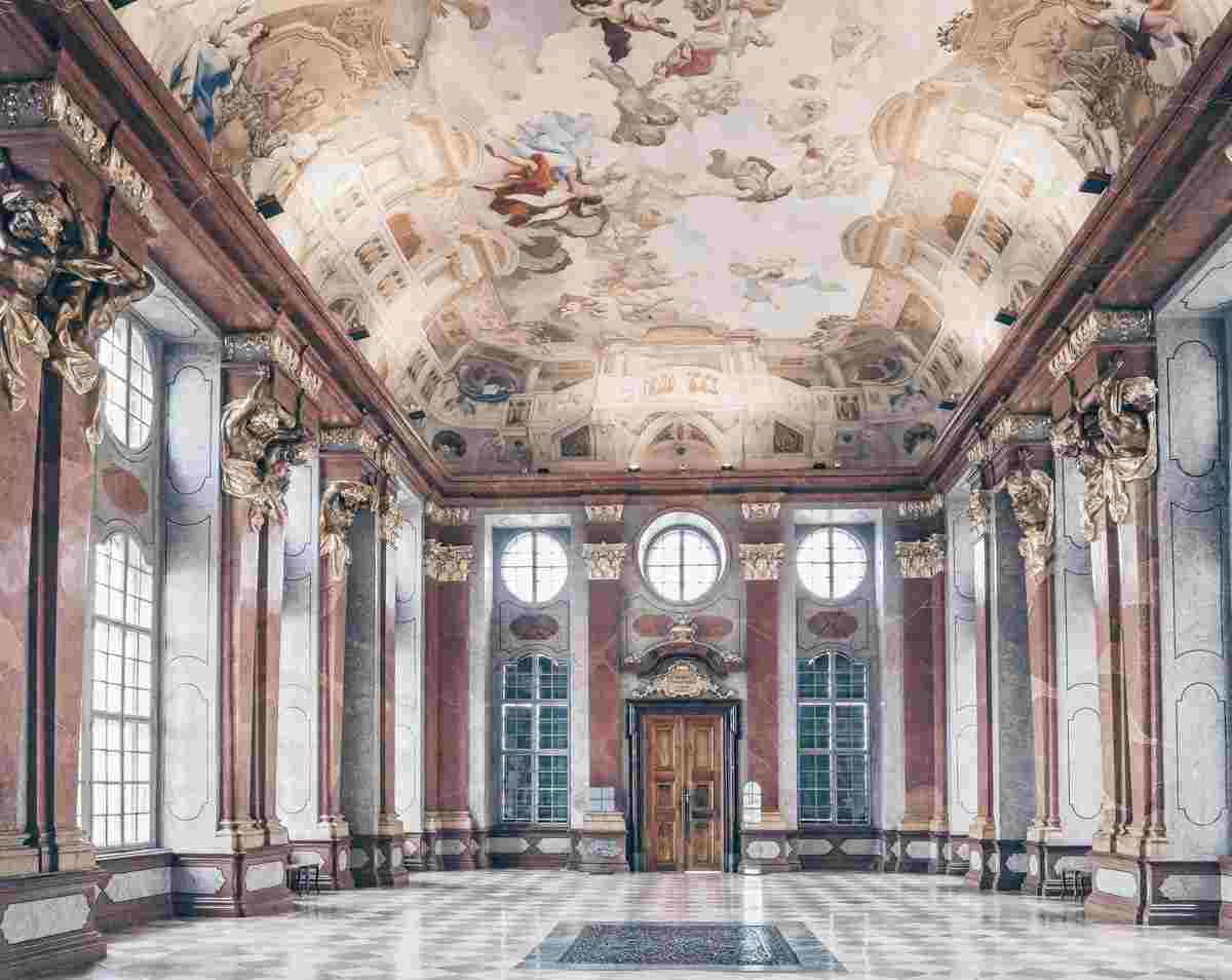 The trompe l'oeil–painted tiers of the red-and-gray Marble Hall of Melk Abbey