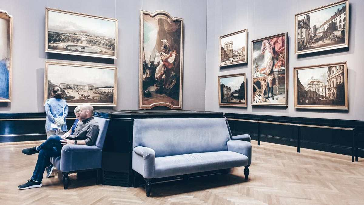 People admiring the rich artworks of the Art History Museum in Vienna