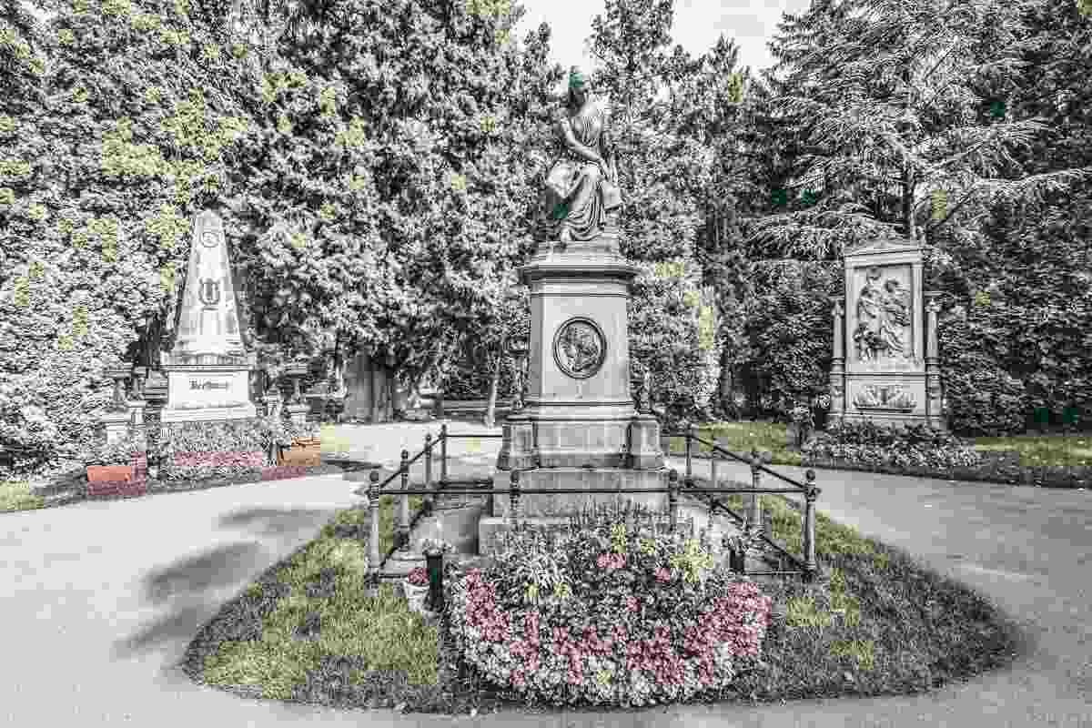 Graves of Beethoven and Schubert, and the Mozart monument at Vienna Central Cemetery. PC: May_Lana/shutterstock.com