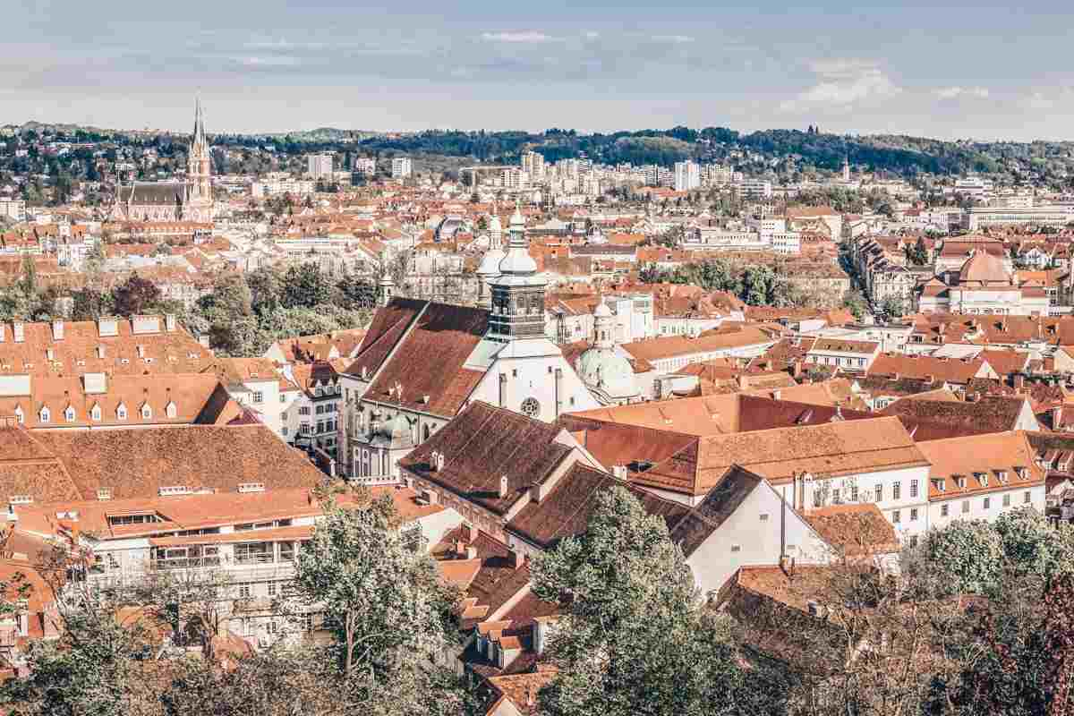 Things to do in Graz: Panoramic view of the red-roofed buildings of the Old Town