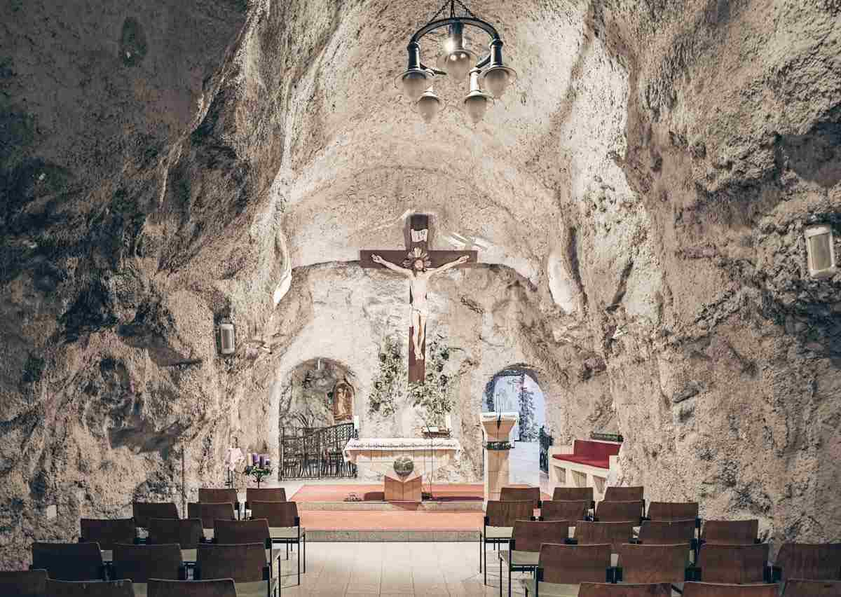 Things to do in Budapest: Main altar and rock wall of the Cave Church. PC: Mikhail Markovskiy/Shutterstock.com