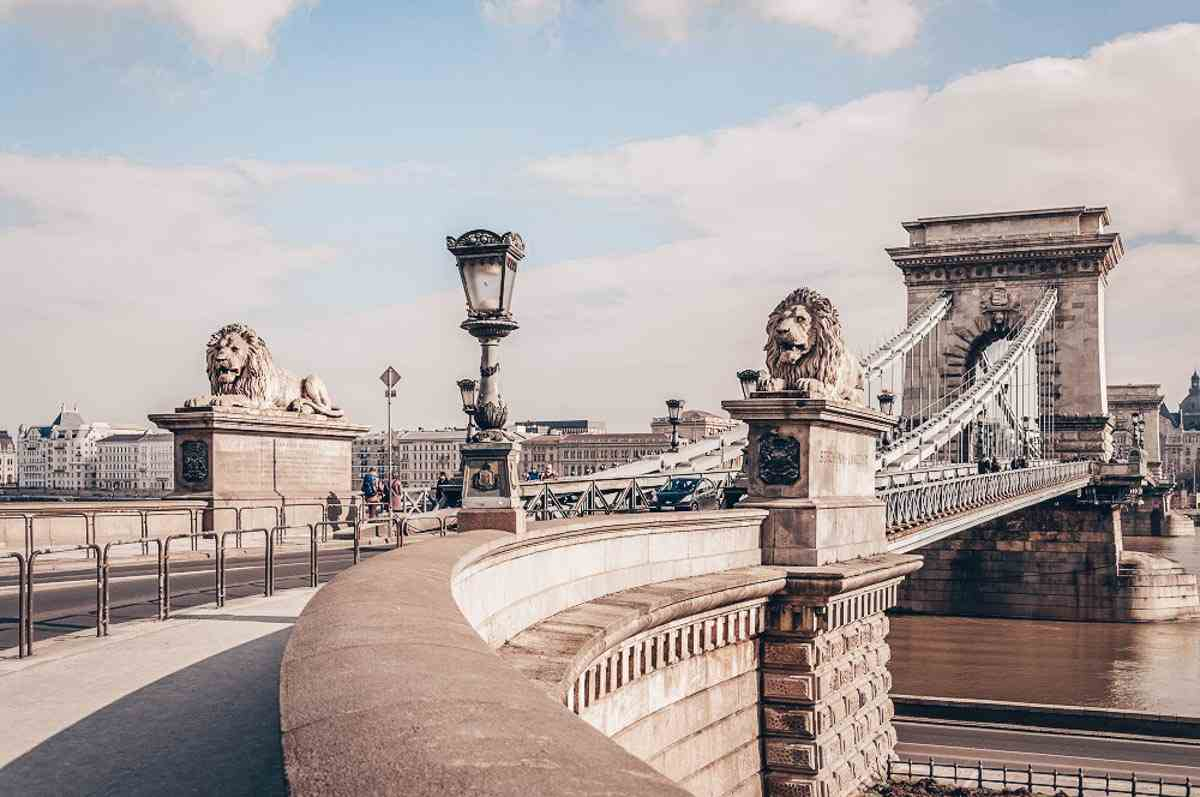 Things to do in Budapest: Pair of imposing stone lions of the Szechenyi Chain Bridge