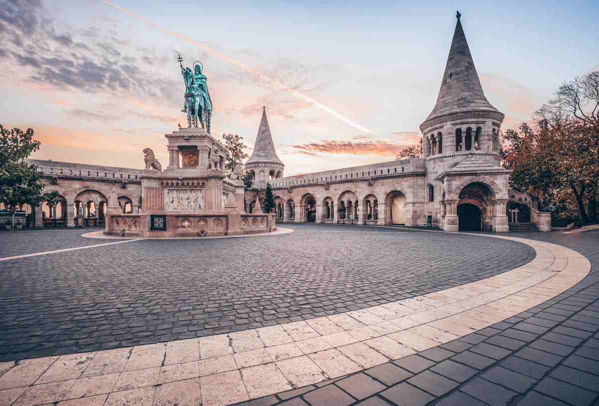 What to do in Budapest: Statue of King Matthias with the Neo-Gothic and Neo-Renaissance towers of Fisherman's Bastion
