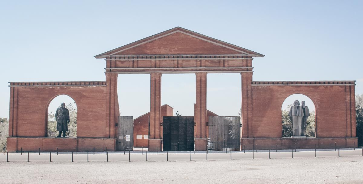 Budapest attractions: Statues of Vladimir Lenin, Karl Marx and Friedrich Engels in a gate at Memento Park