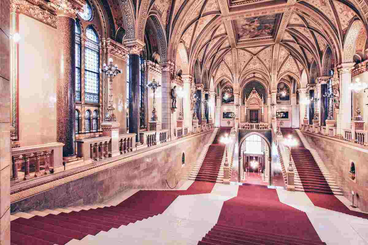 Things to do in Budapest: The sumptuous main staircase and ornate furnishings of the Hungarian Parliament Building