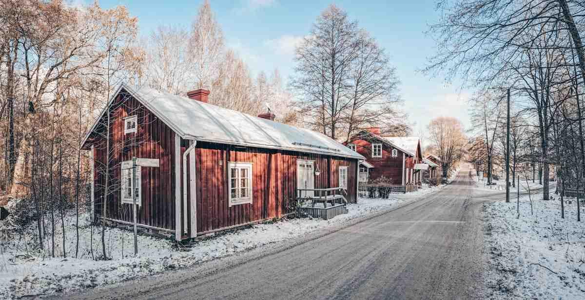 Lovely wooden buildings along a street in Fiskars Village, Finland