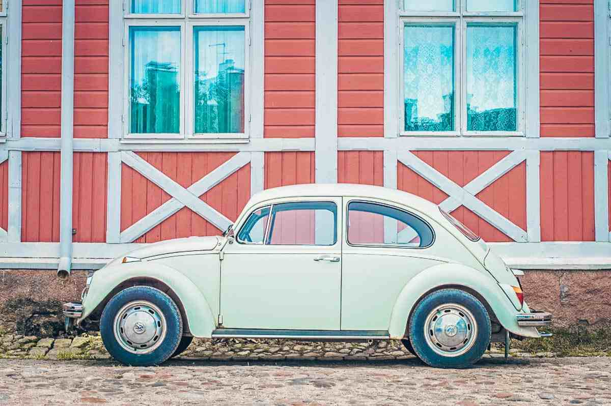Rauma: Vintage car parked outside a wooden house in Old Rauma