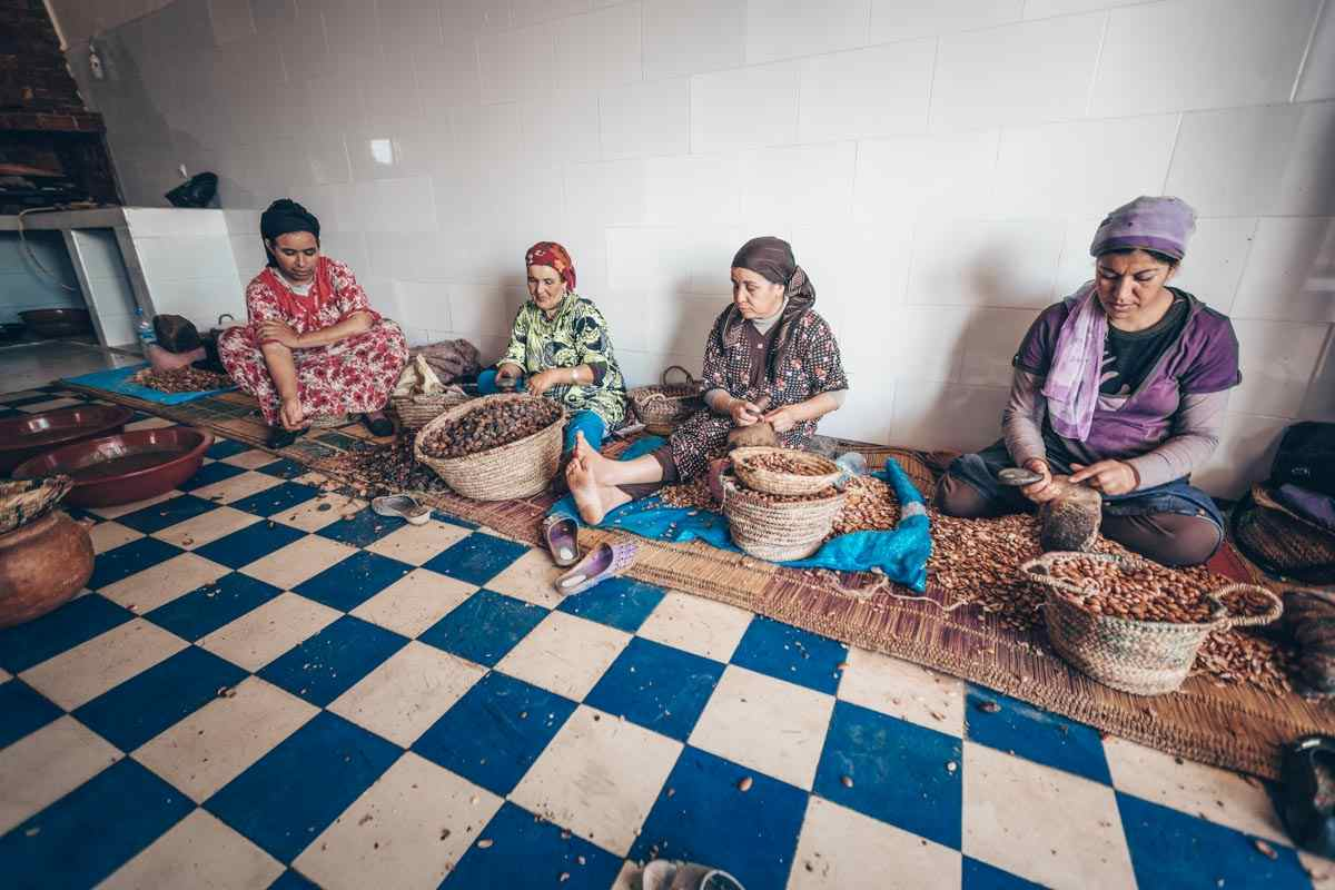 Essaouira: Moroccan women shelling Argan nuts in an Argan Oil Cooperative. PC: Alexander A.Trofimov/Shutterstock.com