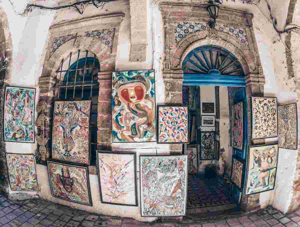 Things to see in Essaouira: Numerous paintings on display at a local art gallery. PC: Pavel Mora/Shutterstock.com