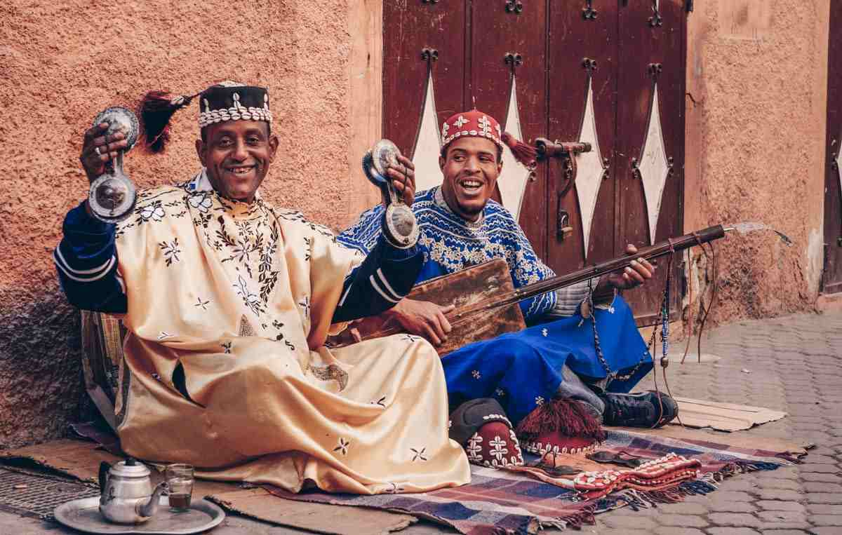 Things to see in Essaouira: Duo of Gnaoua musicians performing on the street. PC: Reimar/Shutterstock.com