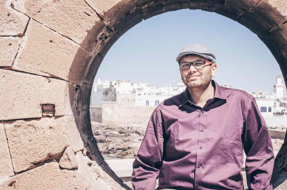 Essaouira: Handsome man posing for a photo at the ramparts on a sunny day