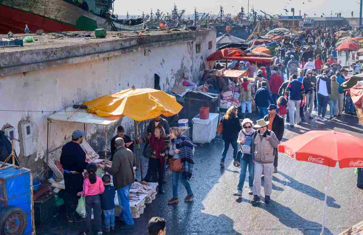 Essaouira: People strolling through the daily fish market in the harbour. PC: Elena Odareeva - Dreamstime.com