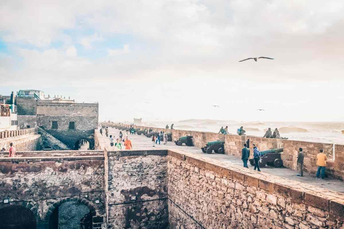 Essaouira: People strolling on the Skala de la Ville ramparts in the evening. PC: Sulo Letta/Shutterstock.com