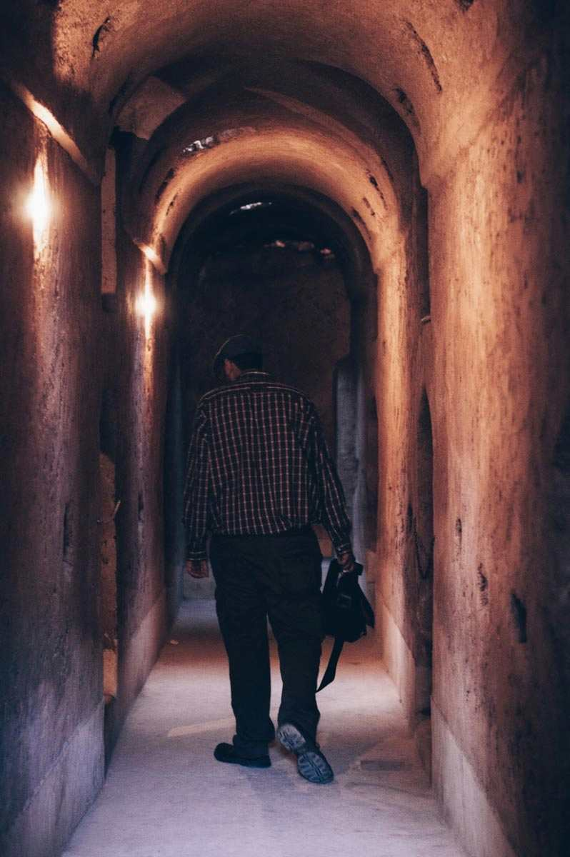Marrakech: Man walking in an underground corridor of the El Badi Palace