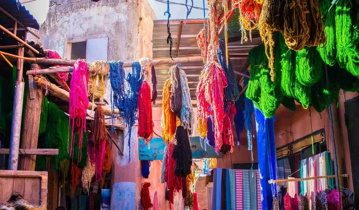 Marrakech Dyer's Souk: Skeins of colorful dyed wool hung out to dry. PC: Pedro Rufo/Shutterstock.com