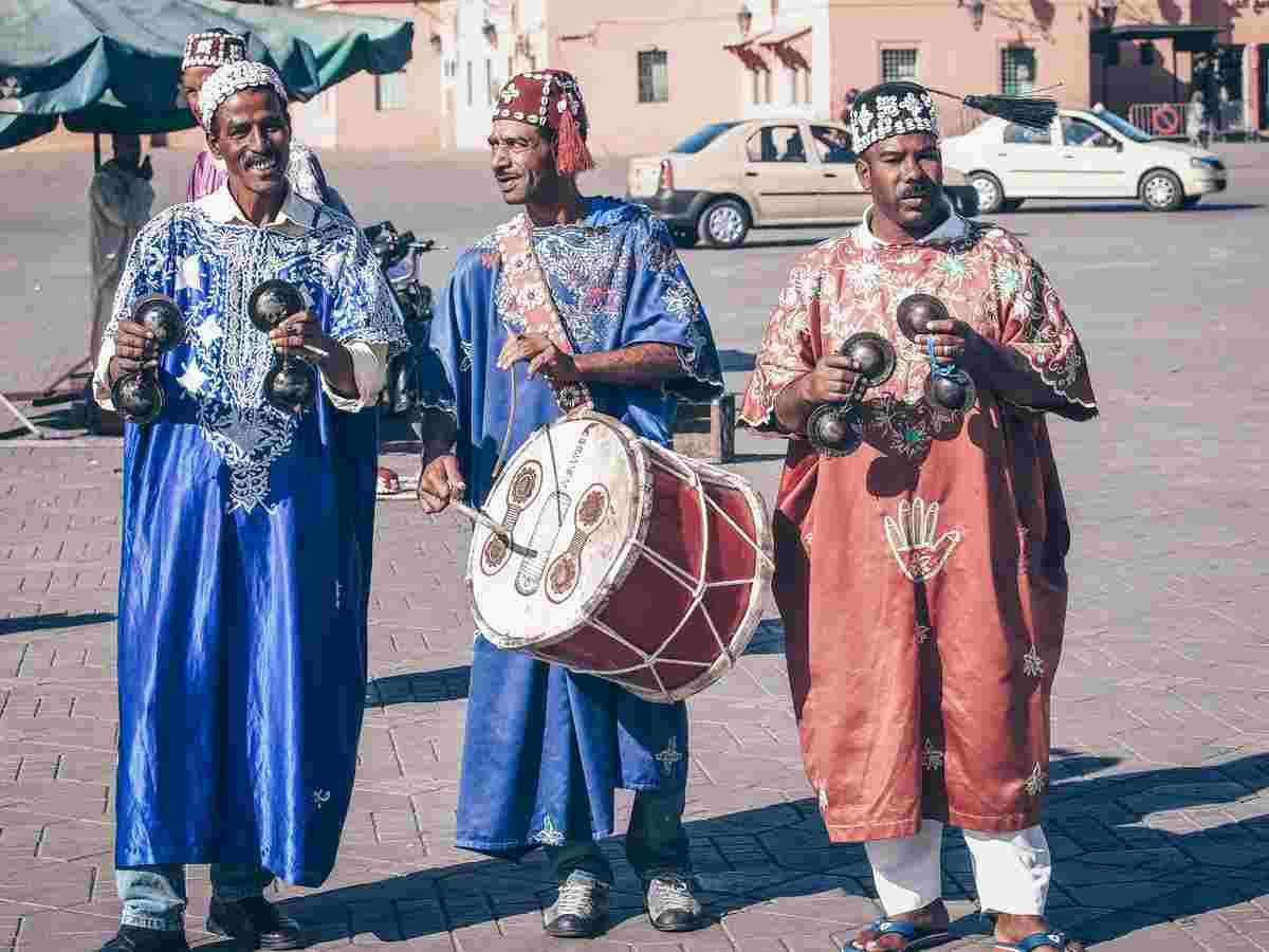 Marrakech: A trio of Gnaoua musicians in traditional attire in Jemaa el Fna. PC: Nevenm - Dreamstime.com