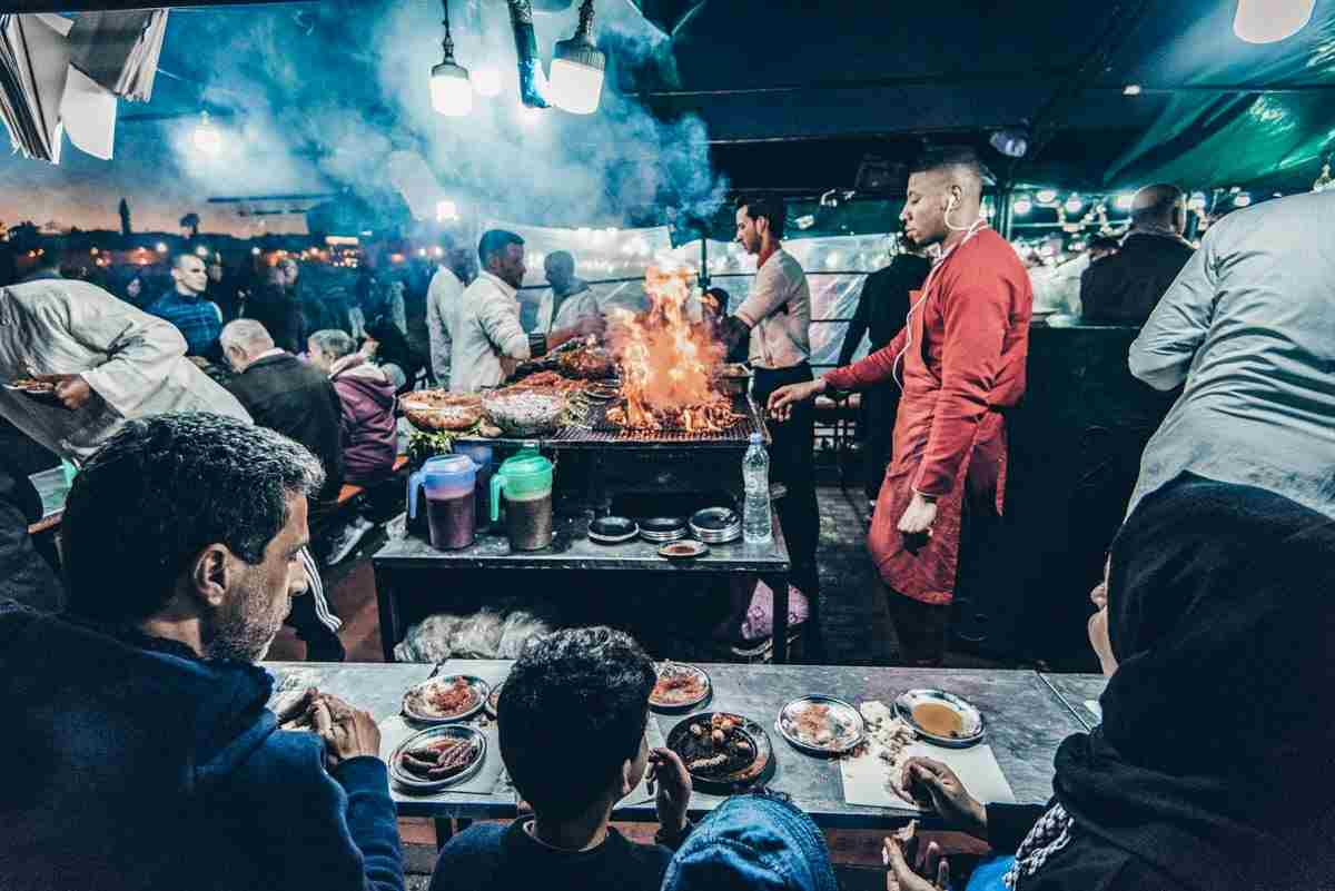 Marrakesh: People dining at the food stalls in Jemaa el Fna in the evening: PC: Marcin Jucha - Dreamstime.com