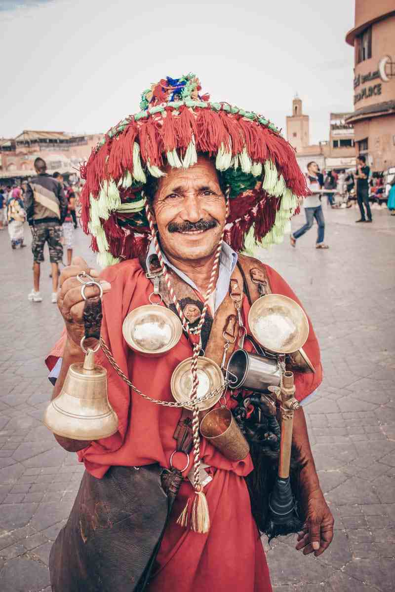 Marrakech: A water seller dressed in a traditional colorful outfit at Jemaa le Fna. PC: Daniel M. Cisilino - Dreamstime.com
