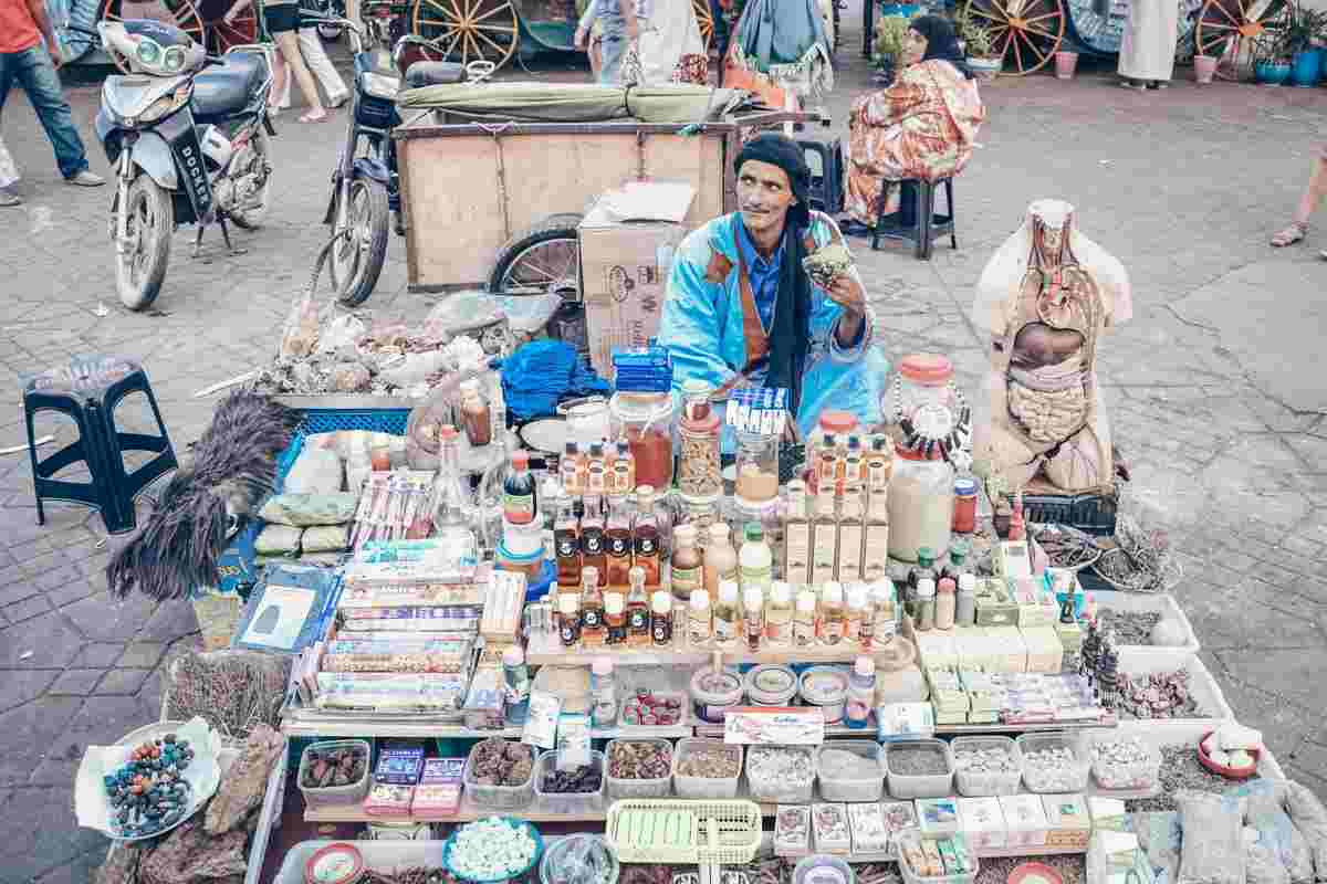 Marrakech: A turbaned herbalist sitting behind his products in Jemaa el Fna. PC: Andreas Wolochow/Shutterstock.com