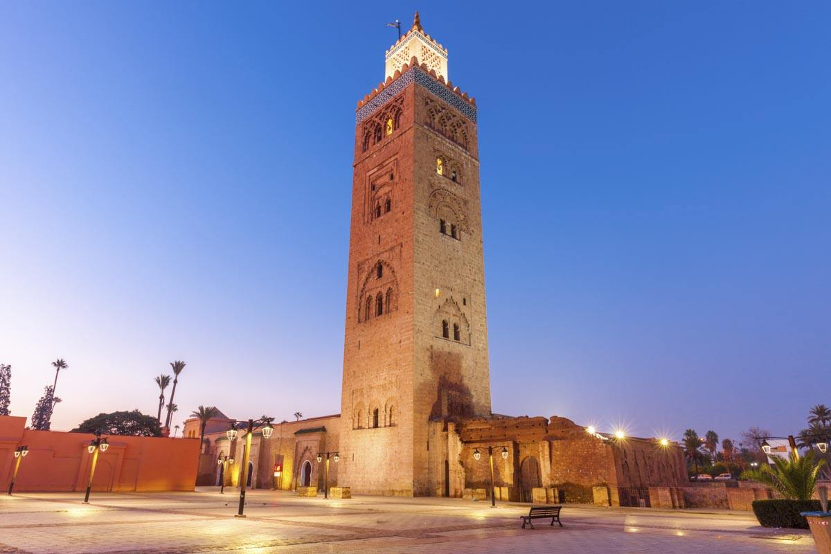 Marrakech: Illuminated minaret of the soaring Koutoubia Mosque in the evening