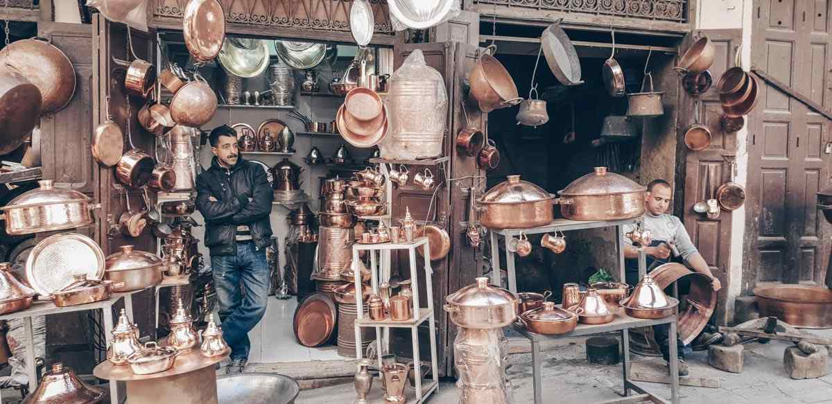 Marrakech Souks: All sorts of copper and bronze utensils on display in the Souk des Chaudronniers. PC: zdig/Shutterstock.com
