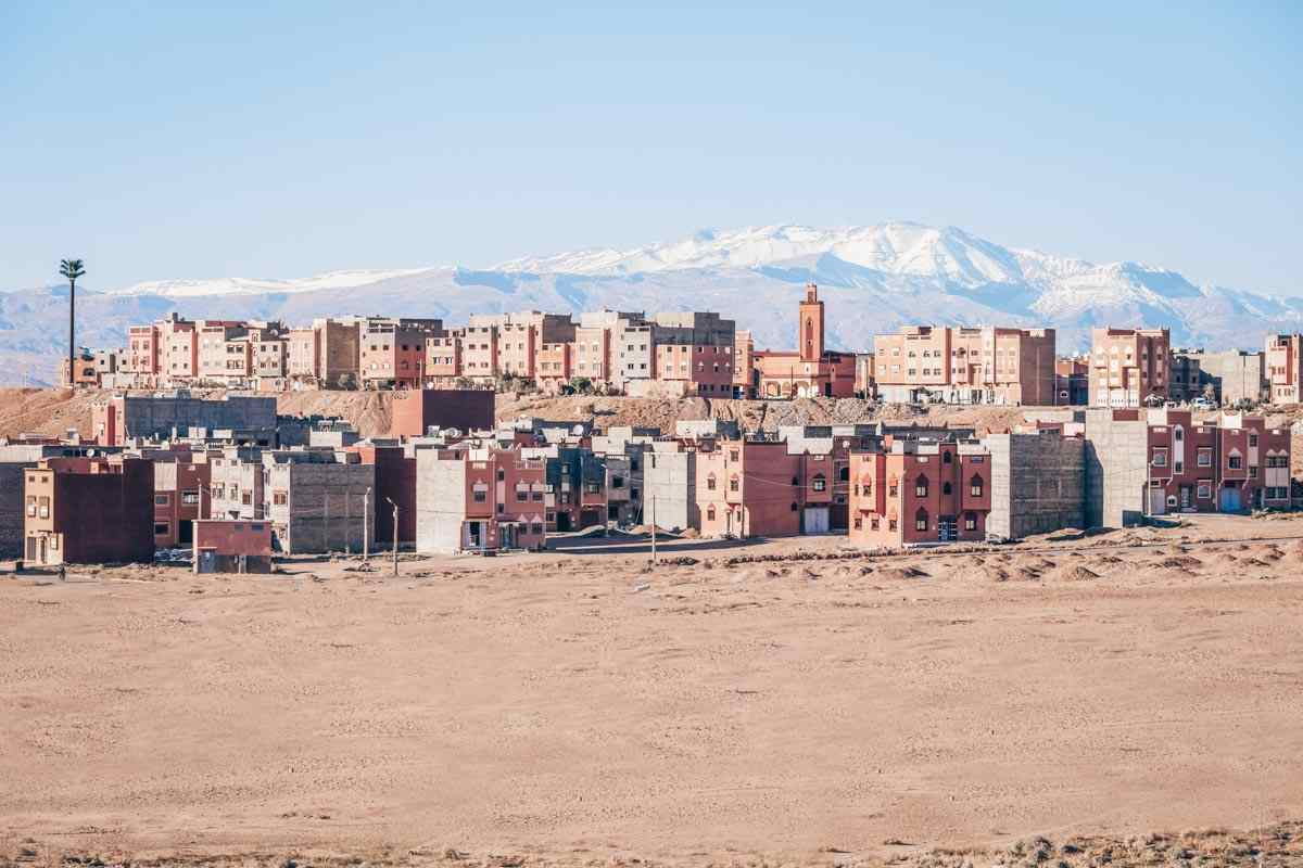 Ouarzazate: Panoramic view of the town with the snow-capped Atlas Mountains in the background