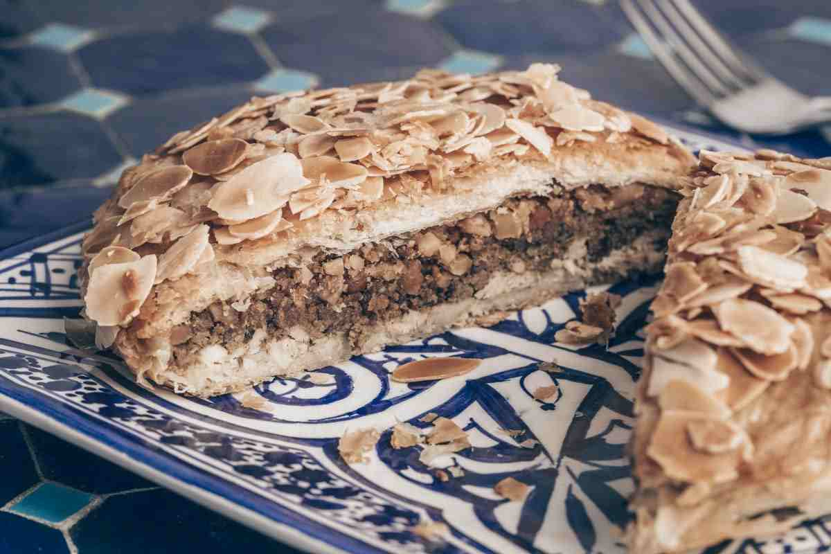 Moroccan food: Pastilla, a savory crispy pie filled with shredded pigeon and topped with almonds