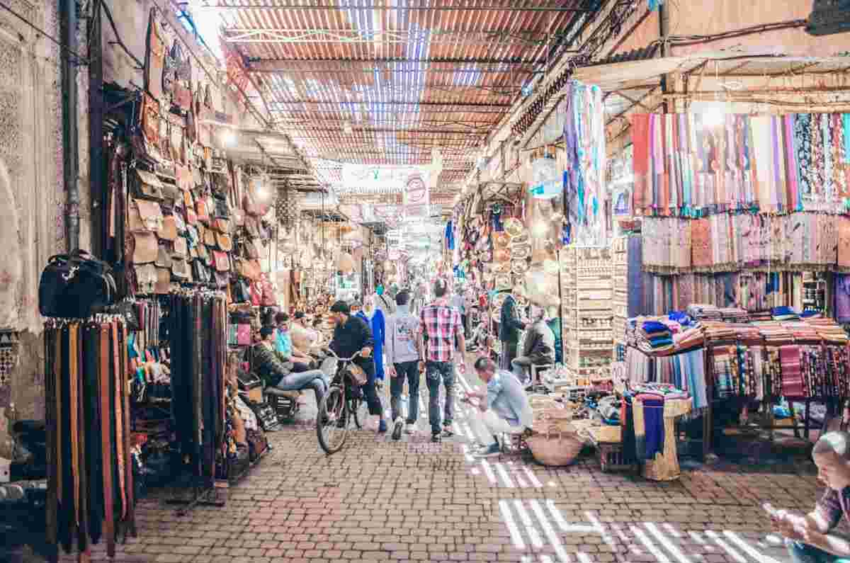 Marrakech Souk Semmarine: People walking among the various stalls in the afternoon. PC: Petrajz - Dreamstime.com