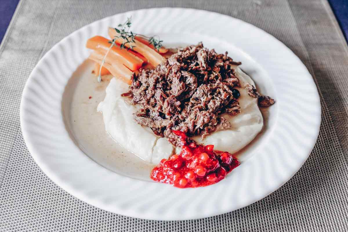 Finnish food: Sautéed reindeer served with mashed potatoes and lingonberries