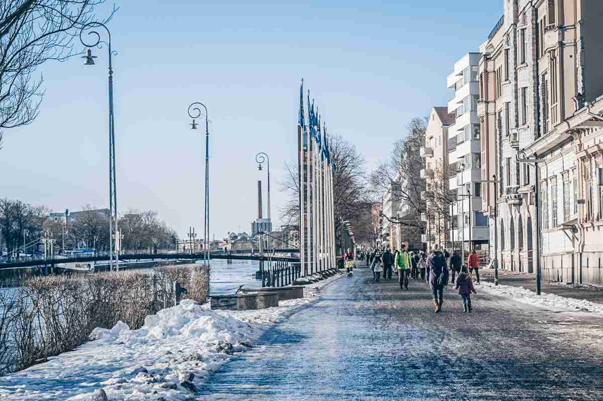 Turku: People walking on the esplanade beside the Aura River on a sunny winter day