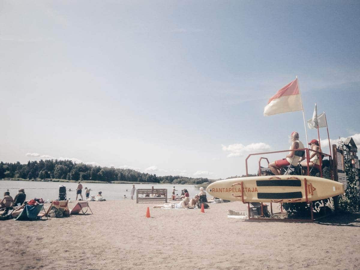 Turku Beach: People relaxing at Ekvalla Beach on a sunny day