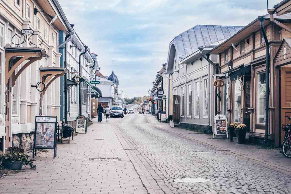 Charming old wooden houses on a cobblestone street in Old Rauma
