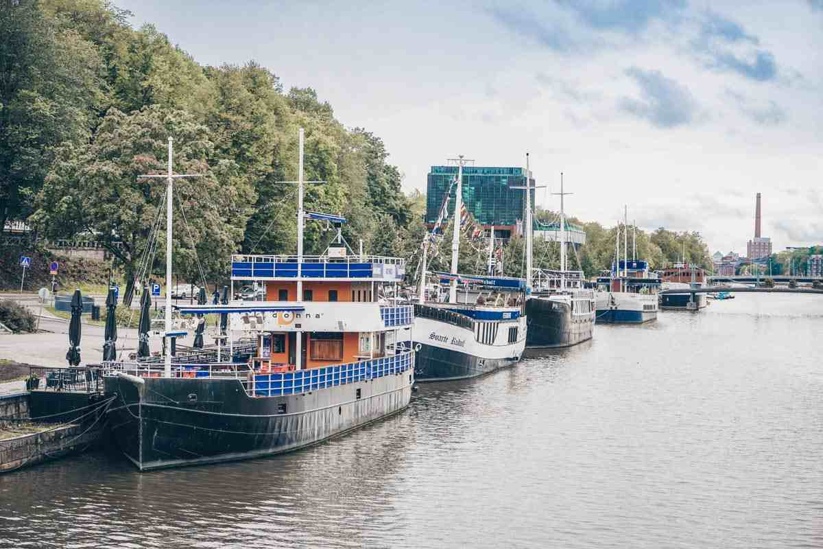 Turku: Riverboats docked on the Aura River. PC: Inspired By Maps/Shutterstock.com