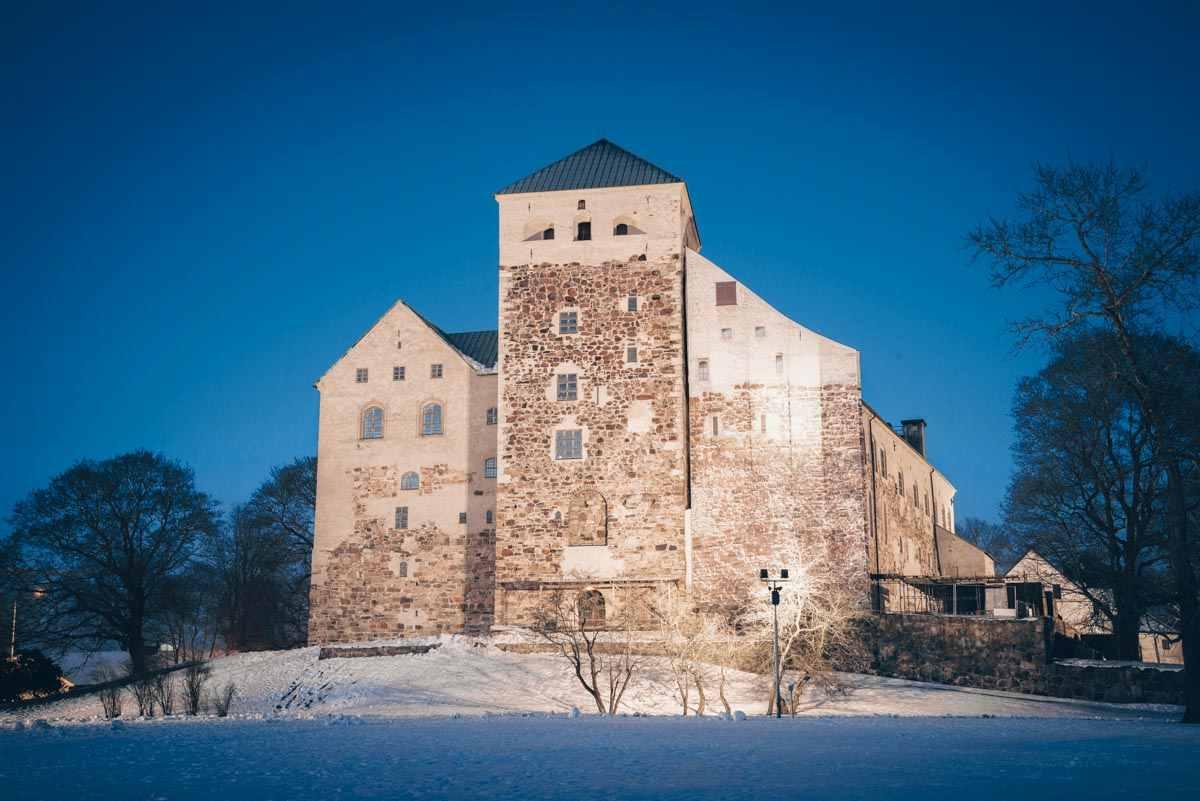 Turku: The illuminated Turku Castle in the winter